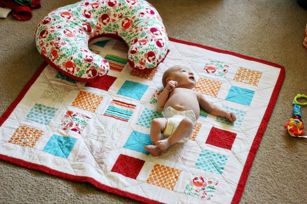 Handmade baby quilt and nursing pillow cover.