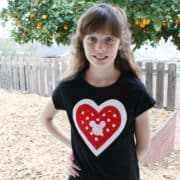 Looking for an easy Valentine's craft? This quick applique technique is easy for kids & adults, resulting in an adorable Valentine's Day heart tee to wear year 'round! There's even a Hidden Mickey Disney detail in the center for added love!