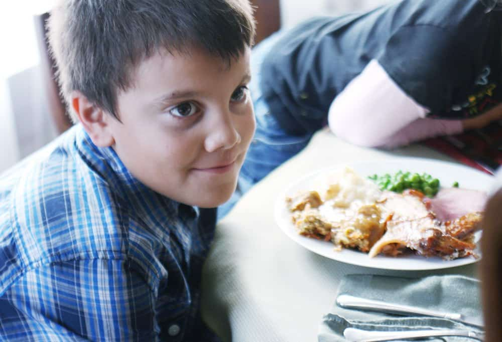 Picky eater at home? These are the tips from a former picky eater on how to encourage your kids to try new foods. With these practical tips for feeding picky eaters you can take the focus off them and encourage healthy habits.